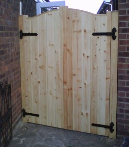 Solid Redwood double gates, black ironmongery